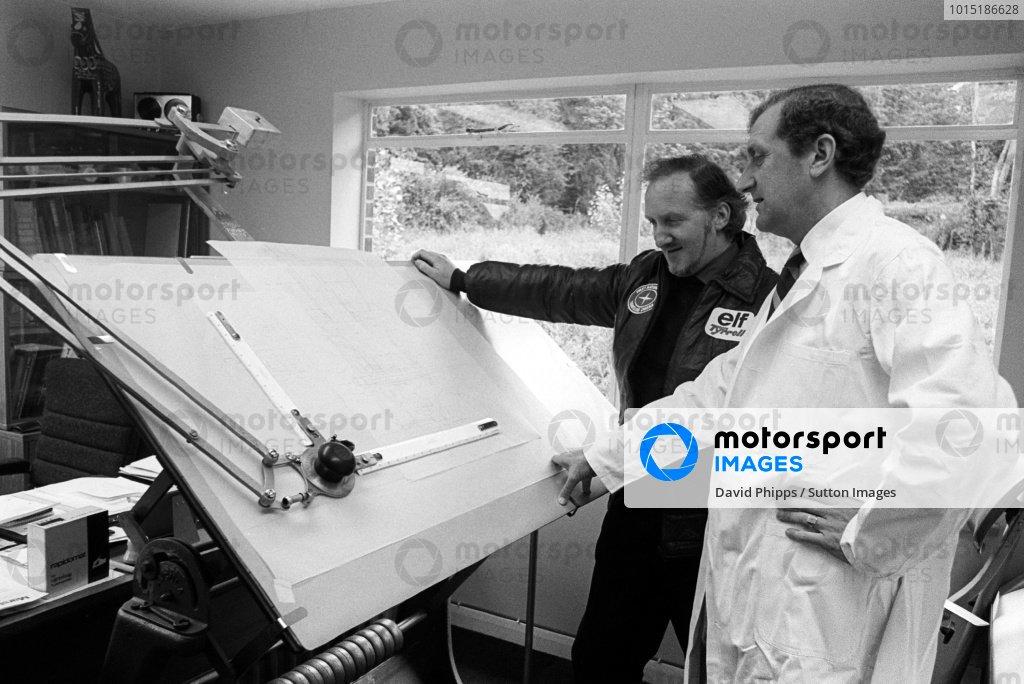 (L to R): Maurice Phillipe (GBR) with fellow Tyrrell Designer Derek Gardner (GBR) looking at plans for the new car.1977 Formula One World Championship, Tyrrell Headquarters, Ockham, Kent, England, c. July 1977.