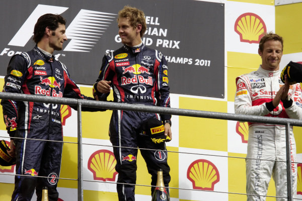 Sebastian Vettel, 1st position, on the podium with Mark Webber, 2nd position, and Jenson Button, 3rd position.