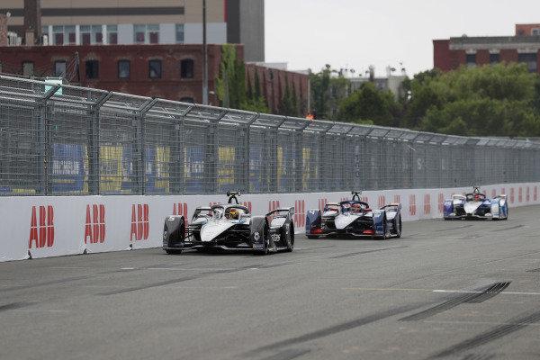 Stoffel Vandoorne (BEL), Mercedes Benz EQ, EQ Silver Arrow 02, leads Robin Frijns (NLD), Envision Virgin Racing, Audi e-tron FE07, and Maximilian Guenther (DEU), BMW I Andretti Motorsports, BMW iFE.21