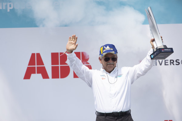 Gerd Mauser, Chairman, Jaguar Racing, collects the teams trophy on the podium