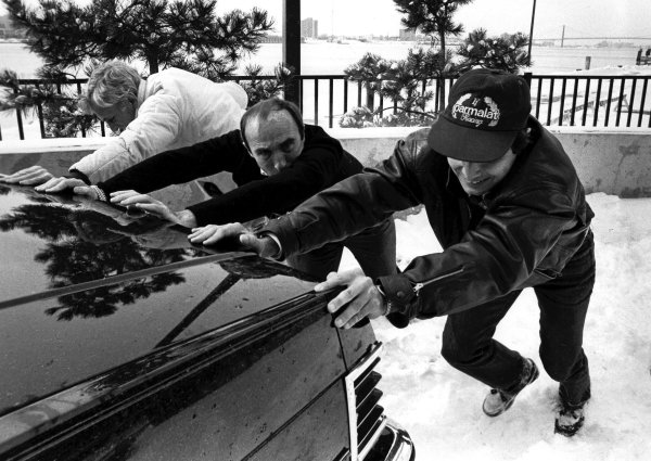 1982 United States Grand Prix East launch.Detroit, Michigan, USA.Nelson Piquet (right) and Frank Williams push their car out of a snow bank on what would be the site of the 1982 Detroit Grand Prix.World Copyright - LAT Photographic