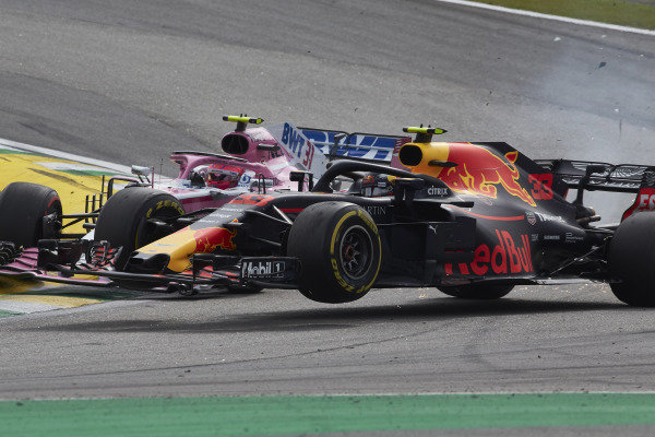 Esteban Ocon, Force India VJM11 Mercedes, collides with race leader Max Verstappen, Red Bull Racing RB14 Tag Heuer.