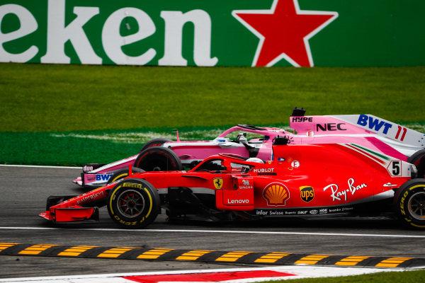 Sebastian Vettel, Ferrari SF71H, battles with Sergio Perez, Racing Point Force India VJM11.
