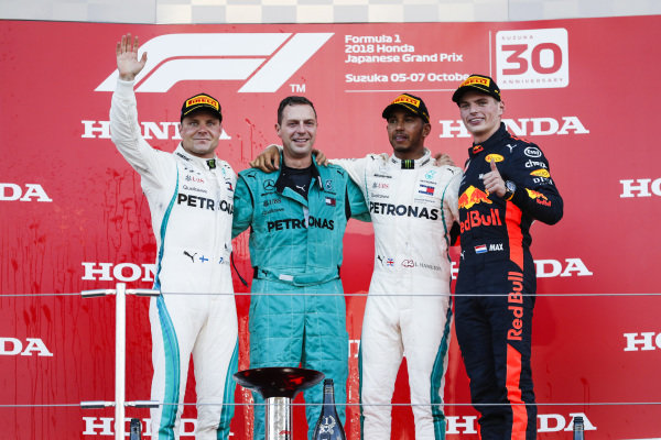 Valtteri Bottas, Mercedes AMG F1, 2nd position, the Mercedes Constructors trophy delegate, Lewis Hamilton, Mercedes AMG F1, 1st position, and Max Verstappen, Red Bull Racing, 3rd position, on the podium