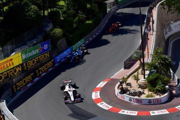 Nikita Mazepin, Haas VF-21, leads Esteban Ocon, Alpine A521, and Charles Leclerc, Ferrari SF21