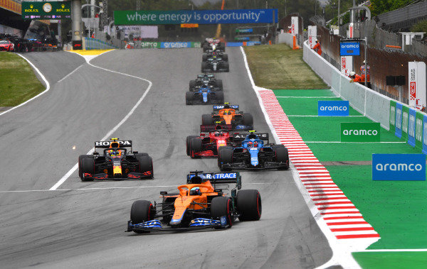 Daniel Ricciardo, McLaren MCL35M, leads Sergio Perez, Red Bull Racing RB16B, Esteban Ocon, Alpine A521, and Carlos Sainz, Ferrari SF21