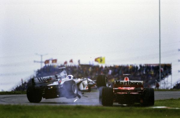 David Coulthard, McLaren MP4-13 Mercedes, collides with Michael Schumacher, Ferrari F300.