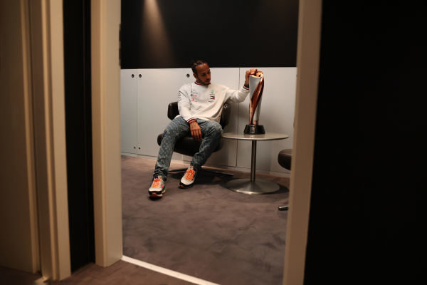 Lewis Hamilton, Mercedes-AMG Petronas F1, with his winners trophy in the drivers room after the race