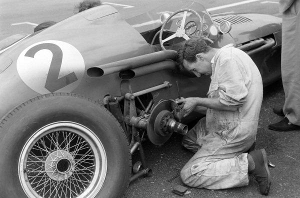 A mechanic works on Roy Salvadori's Aston Martin DBR4/250.