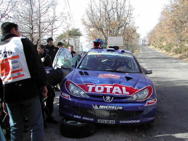 2002 World Rally ChampionshipMonte Carlo Rally, 17-20 January 2002.Harri Rovanpera's stranded Peugeot 206 WRC (broken steering arm).Photo: Ralph Hardwick/LAT