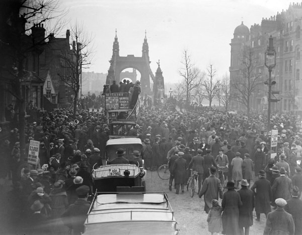 Traffic and crowds at Hammersmith Bridge, London, for the University Boat Race