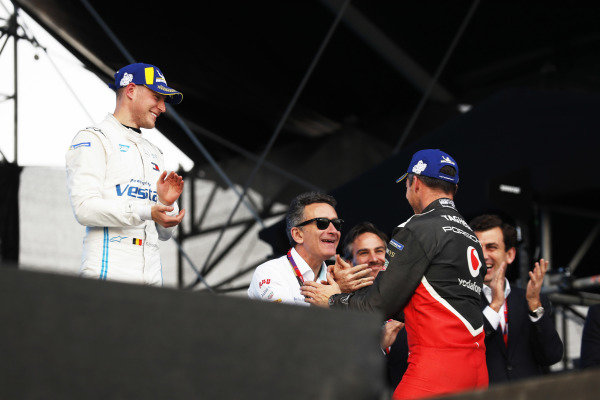 Stoffel Vandoorne (BEL), Mercedes Benz EQ Formula, EQ Silver Arrow 01, and Andre Lotterer (DEU), Tag Heuer Porsche, Porsche 99x Electric, on the podium with Alejandro Agag, Chairman of Formula E
