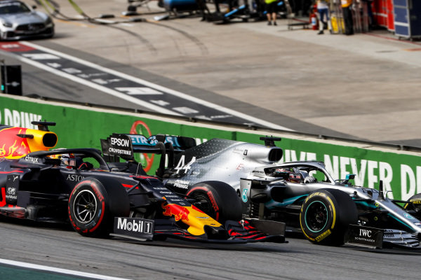 Lewis Hamilton, Mercedes AMG F1 W10, battles with Max Verstappen, Red Bull Racing RB15, at the first restart