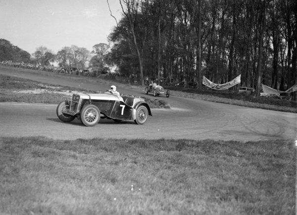 A car leads a Bugatti.