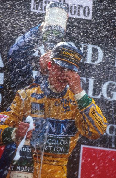 1993 Belgian Grand Prix.Spa-Francorchamps, Belgium.27-29 August 1993.Michael Schumacher (Benetton Ford) celebrates 2nd position on the podium.Ref-93 BEL 06.World Copyright - LAT Photographic