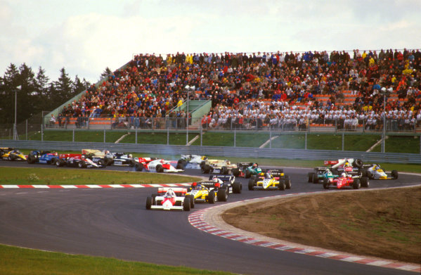 Nurburgring, Germany.5-7 October 1984.Alain Prost (McLaren MP4\2 TAG Porsche) leads Patrick Tambay (Renault RE50), Nelson Piquet (Brabham BT53 BMW) and Derek Warwick (Renault RE50) at the start. Others lock up coming into the Castrol-S as Ayrton Senna (Toleman TG184 Hart) crashes into Keke Rosberg (Williams FW09B Honda).Ref-84 EUR 10.World Copyright - LAT Photographic