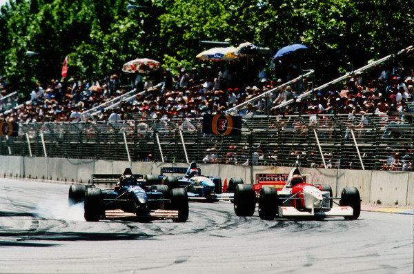 1995 Australian Grand Prix. Adelaide, Australia. 10-12 November 1995. Heinz-Harald Frentzen (Sauber C14 Ford) locks up as he dives down the inside of Mark Blundell (McLaren MP4/10B Mercedes). Ref-95 AUS 08. World Copyright - LAT Photographic