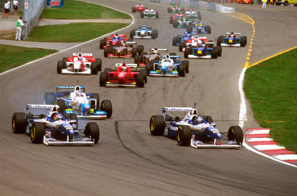 Montreal, Quebec, Canada.14-16 June 1996.Damon Hill (Williams FW18 Renault) beats teammate Jacques Villeneuve (Williams FW18 Renault) into Senna Corner, followed by Jean Alesi (Benetton B196 Renault).Ref-96 CAN 03.World Copyright - LAT Photographic