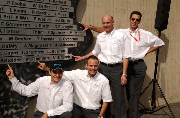 Timo Scheider (GER), OPC Team Phoenix, Portrait, Marcel Tiemann (GER), Opel DTM Taxi Driver, Volker Strycek (GER), Opel Motosport Director, and Manuel Reuter (GER), OPC Team Holzer, pointing to their own names on the winners sign. Revealing of the winners names of the Nürburgring 24Hrs race. DTM Championship, Rd 7, Nürburgring, Germany. 16 August 2003. DIGITAL IMAGE