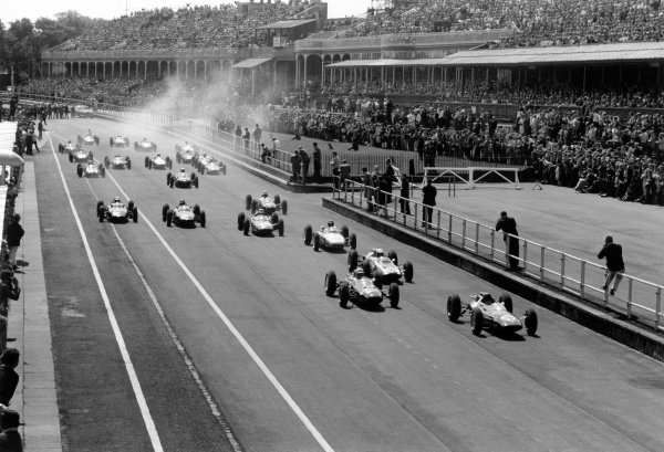 1962 British Grand Prix.Aintree, Great Britain. 19-21 July 1962.Jim Clark (#20 Lotus 25-Climax) leads John Surtees (#24 Lola Mk4-Climax), Bruce McLaren (#16 Cooper T60-Climax), Dan Gurney (#8 Porsche 804), Jack Brabham (#30 Lotus 24-Climax), Graham Hill (#12 BRM P57), Richie Ginther (#14 BRM P57), Roy Salvadori (#26 Lola Mk4-Climax) and Phil Hill (#2 Ferrari Dino 156) at the start. Clark and Surtees finished in 1st and 2nd position respectively.World Copyright: LAT PhotographicRef: Autosport b&w print