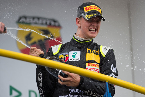 Race two winner Mick Schumacher (GER) Van Amersfoort Racing celebrates on the podium with the champagne at German Formula Four Championship, Rd1, Oschersleben, Germany, 24-26 April 2015.