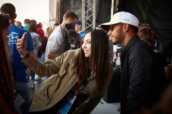 Sochi Autodrom, Sochi, Russia. Thursday 27 April 2017. Lewis Hamilton, Mercedes AMG, has his picture taken by a fan. World Copyright: Steve Etherington/LAT Images ref: Digital Image SNE16161