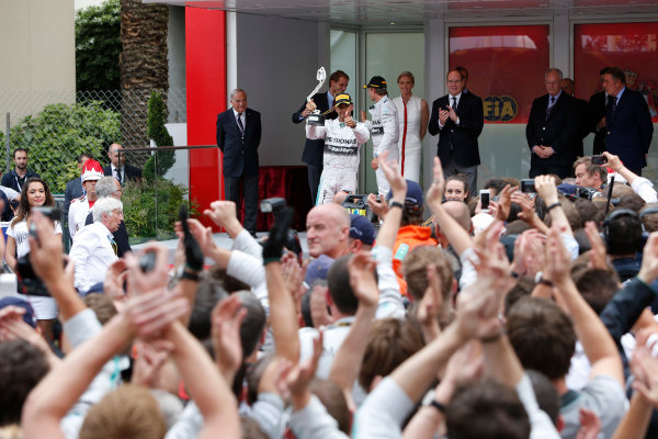 Monte Carlo, Monaco. Sunday 25 May 2014. Lewis Hamilton, Mercedes AMG, 2nd Position, lifts his trophy on the podium. World Copyright: Andrew Ferraro/LAT Photographic. ref: Digital Image _FER7092