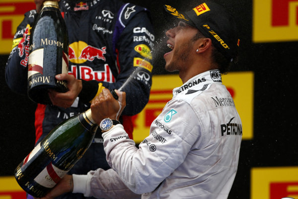 Circuit de Catalunya, Barcelona, Spain. Sunday 11 May 2014. Lewis Hamilton, Mercedes AMG, 1st Position, sprays the victory Champagne. World Copyright: Andy Hone/LAT Photographic. ref: Digital Image _ONY2288