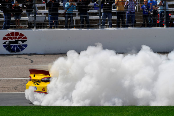 4-6 April, 2014, Fort Worth, Texas USA Joey Logano does a burnout after winning. © 2014, Jennifer Coleman LAT Photo USA