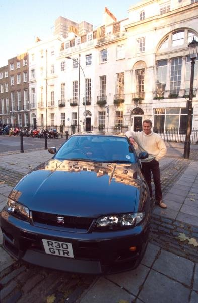 Johnny Herbert (GBR) with a Nissan Skyline GTR at home in London. Formula One Drivers At Home