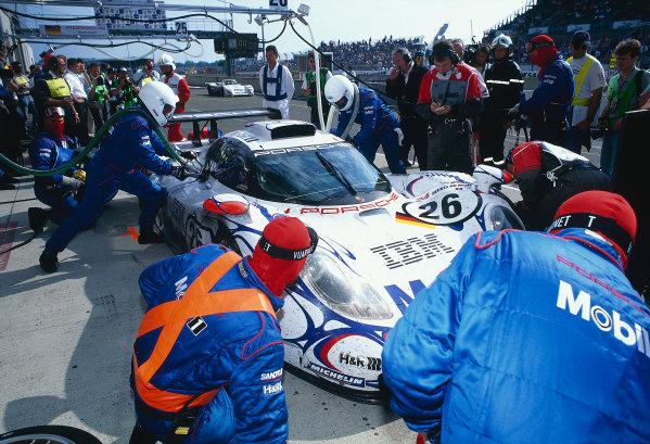 Le Mans, France. 6th - 7th June 1998. Allan McNish/Laurent Aiello/Stephane Ortelli (Porsche 911 GT1-98) 1st position, pit stop action. World Copyright: Jeff Bloxham/LAT Photographic. Ref: 98LM