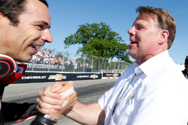 1 June, 2014, Detroit, Michigan, USA Winner Helio Castroneves is congratulated by  Jim Campbell of Chevrolet ©2014, Michael L. Levitt LAT Photo USA