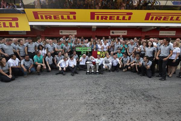 Circuit de Catalunya, Barcelona, Spain. Sunday 11 May 2014. Lewis Hamilton, Mercedes AMG, 1st Position, Nico Rosberg, Mercedes AMG, 2nd Position, and the Mercedes AMG team celebrate a perfect weekend. World Copyright: Steve EtheringtonLAT Photographic. ref: Digital Image SNE25448 copy