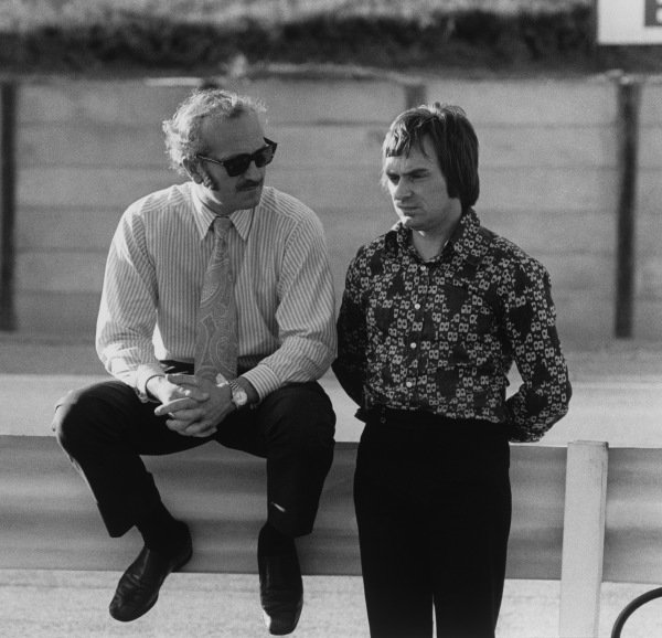 Kyalami, South Africa. 2nd - 4th July 1972.Lotus boss Colin Chapman chats with Brabham boss Bernie Ecclestone in the paddock, portrait.World Copyright: LAT Photographic.Ref:  4289 - 24A.