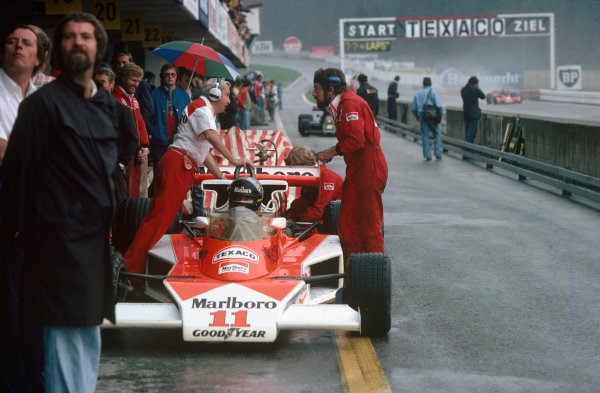 Osterreichring, Zeltweg, Austria. 13th - 15th August 1976.  James Hunt (McLaren M23-Ford), 4th position, in the pits, action.  World Copyright: LAT Photographic. Ref: 76 AUT 14.
