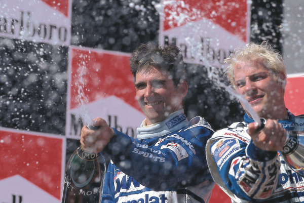 Hungaroring, Budapest, Hungary.8-10 August 1997.Jacques Villeneuve (Williams Renault) and Damon Hill (Arrows Yamaha) after finishing in 1st and 2nd positions respectively. Ref-Motorsport Catalogue p30, 97 HUN 09.Please Note: This image is available as a 30mb+ CMYK Tiff scan upon request.World Copyright - LAT Photographic