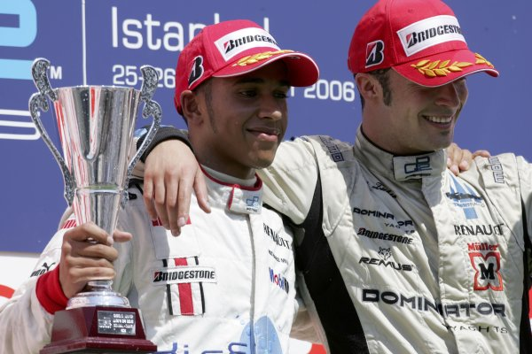 2006 GP2 Series. Round 10.Istanbul Park, Istanbul Turkey.27th August 2006.Sunday Race.Andreas Zuber (AUT, Trident Racing) celebrates victory on the podium with Lewis Hamilton (GBR, ART Grand Prix).World Copyright: Charles Coates/GP2 Series Media Service.ref: Digital Image MB5C8611
