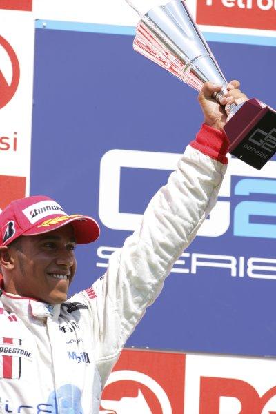 2006 GP2 Series. Round 10. Istanbul Park, Istanbul Turkey. 27th August 2006. Sunday Race. Lewis Hamilton (GBR, ART Grand Prix) celebrates his second position on the podium. World Copyright: Lorenzo Bellanca/GP2 Series Media Service. ref: Digital Image ZD2J8633