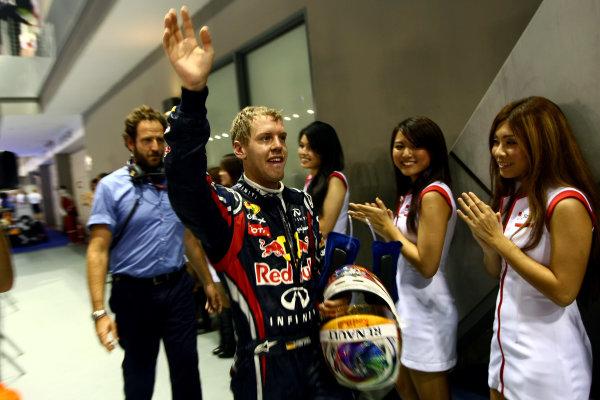 Marina Bay Circuit, Singapore.25th September 2011.Sebastian Vettel, Red Bull Racing RB7 Renault, 1st position. Portrait. Helmets. Finish. World Copyright: Andy Hone/LAT Photographicref: Digital Image CSP29336