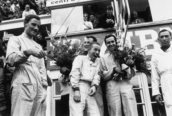 Le Mans, France. 15th - 16th June 1963 L to R: Graham Hill, Richie Ginther, Ludovico Scarfiotti and Lorenzo Bandini, 1st position, on the podium, portrait. World Copyright: LAT Photographic Ref:  B/WPRINT.