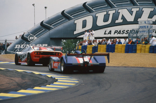 1995 Le Mans 24 Hours. Le Mans, France. 17th - 18th June 1995. John Nielsen/Jochen Mass/Thomas Bscherleads (McLaren F1 GTR), retired, leads Henri Pescarolo/Franck Lagorce/Eric Bernard (Courage C41), retired, action.  World Copyright: LAT Photographic. Ref:  95LM29