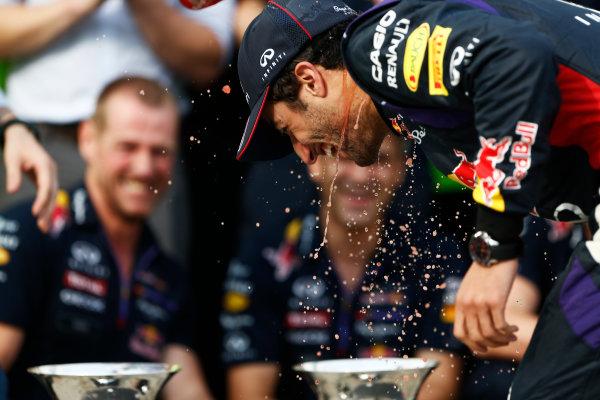 Hungaroring, Budapest, Hungary. Sunday 27 July 2014. Daniel Ricciardo, Red Bull Racing, 1st Position, celebrates with his team. World Copyright: Sam Bloxham/LAT Photographic. ref: Digital Image _SBL1264