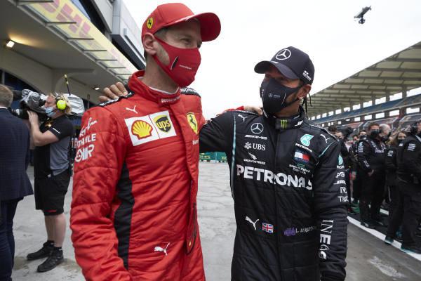 Sebastian Vettel, Ferrari, congratulates Lewis Hamilton, Mercedes-AMG Petronas F1, after winning his 7th championship