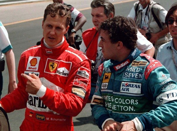 1997 Canadian Grand Prix.Montreal, Quebec, Canada.13-15 June 1997.Michael Schumacher (Ferrari) and Jean Alesi (Benetton Renault) after the race was stopped prematurely. They finished in 1st and 2nd positions respectivelyWorld Copyright - LAT Photographic