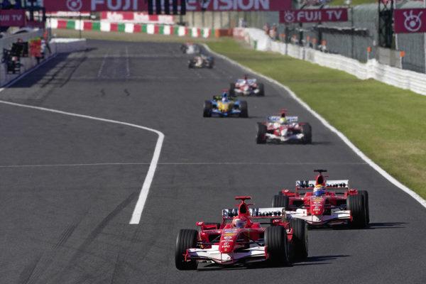 Michael Schumacher, Ferrari 248 F1 leads Felipe Massa, Ferrari 248 F1 and Ralf Schumacher, Toyota TF106B.