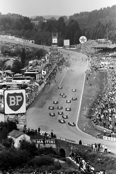 Pole sitter and race winner John Surtees (GBR) Ferrari 312 leads the field into Eau Rouge at the start of the race.  Belgian Grand Prix, Spa-Francorchamps, 12 June 1966.