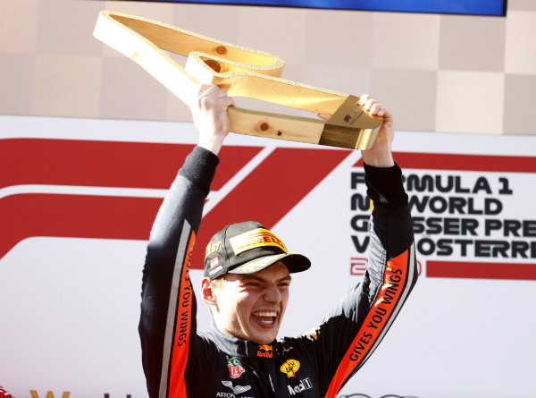 Max Verstappen, Red Bull Racing, 1st position, if his trophy on the podium