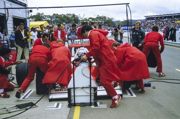 Alain Prost, McLaren MP4-2C TAG, makes a pitstop.