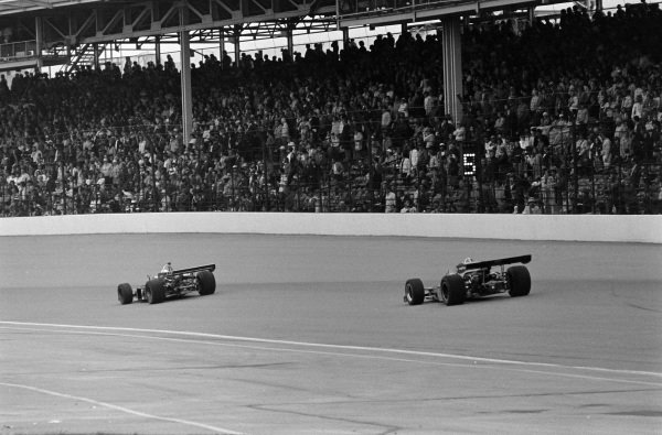 Johnny Rutherford, McLaren M16C Offenhauser, follows Lloyd Ruby, Commander Racing Team/Mike Slater, Eagle 72 Offenhauser, during a caution period.
