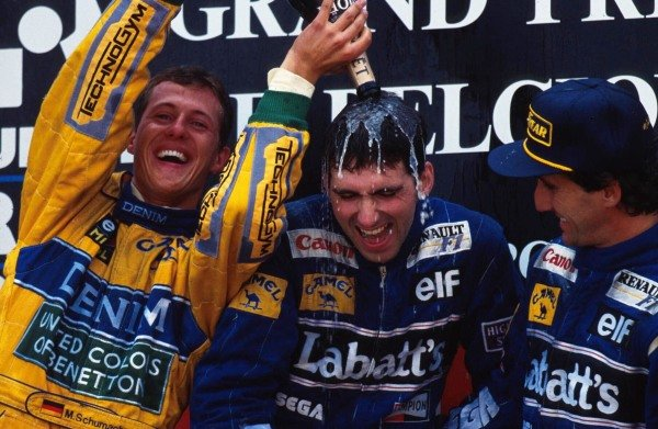 Celebrations on the podium (L to R): Michael Schumacher (GER) Benetton second; Damon Hill (GBR) Williams winner; Alain Prost (FRA) Williams third.  Belgian Grand Prix, Spa-Francorchamps, 29 August 1993.